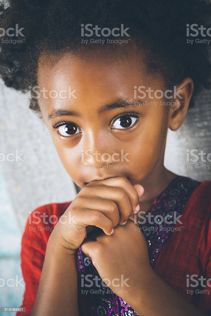 Sad or scared Ethiopian child with big brown eyes stock photo