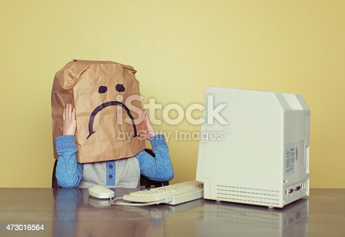 istock Sad Paper Bag Boy is Cyber Bullying Victim 473016564