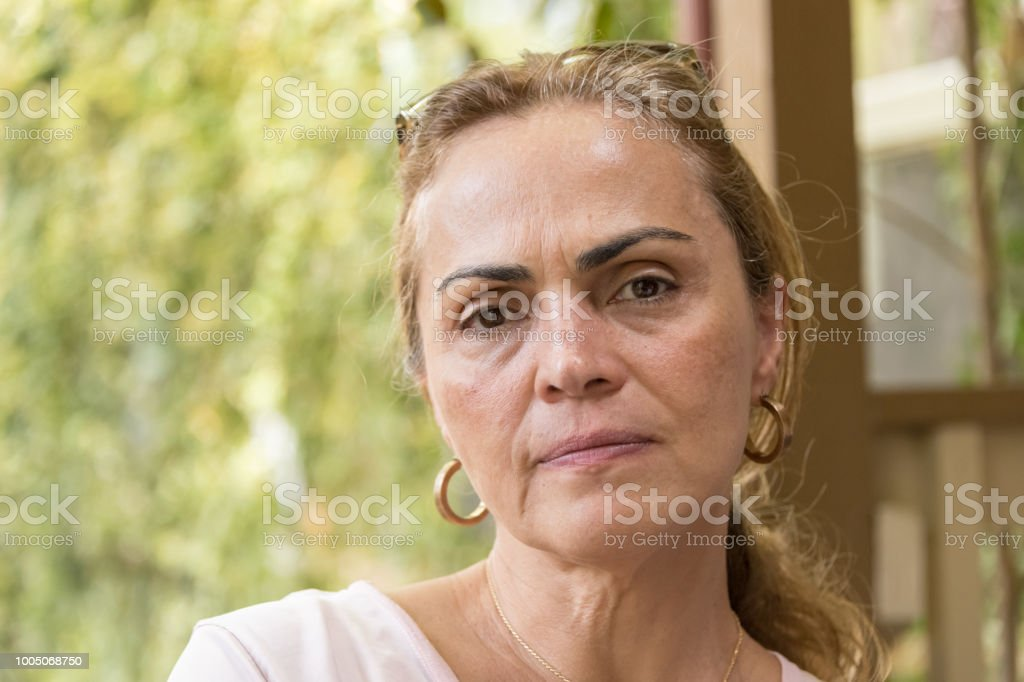 Sad pensive mature woman stock photo