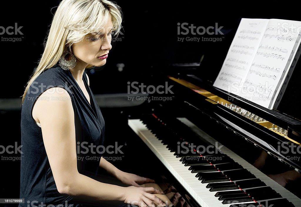Sad pianist. royalty-free stock photo