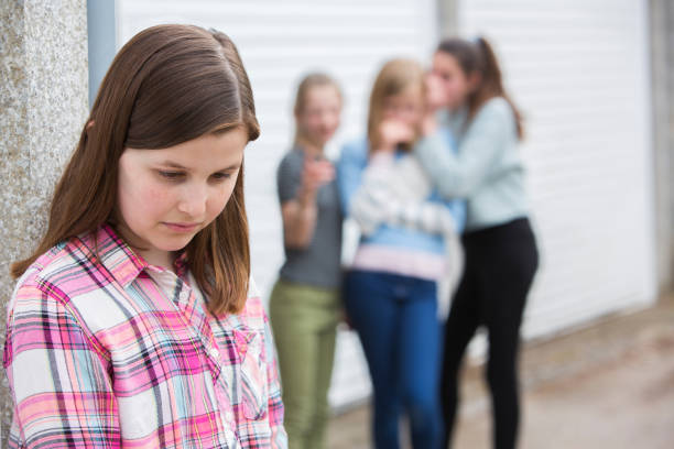 Sad Pre Teen Girl Feeling Left Out By Friends stock photo