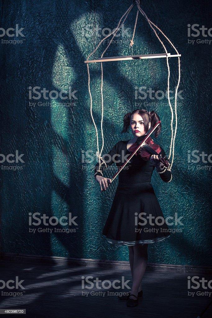 Sad Puppet Violinist stock photo