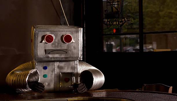 traurig roboter in der bar - bier kostüm stock-fotos und bilder