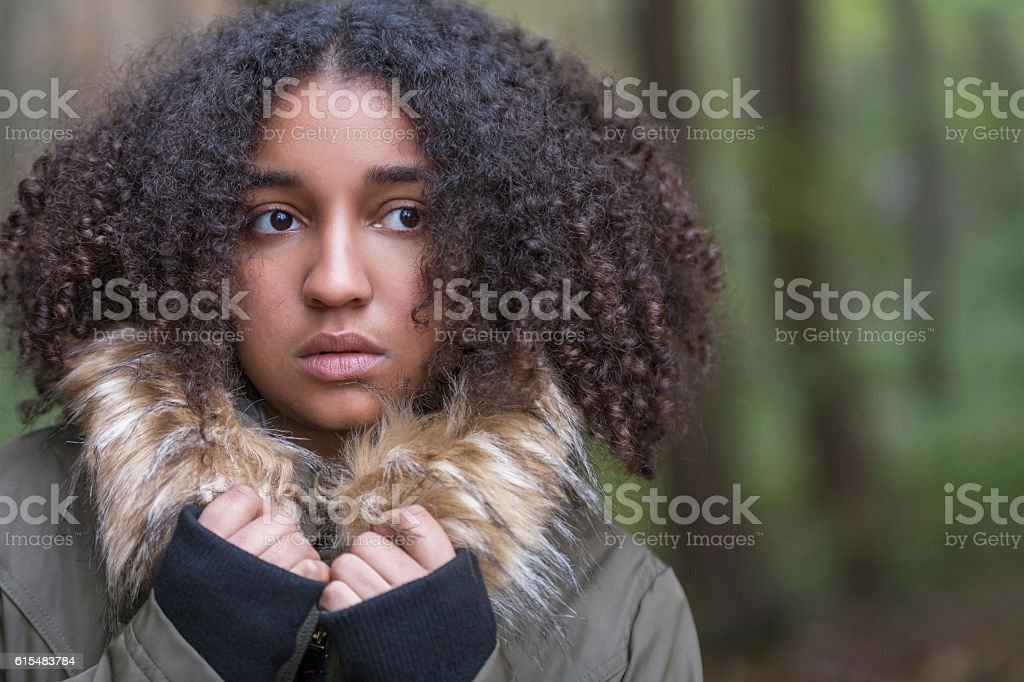 Sad Scared Mixed Race African American Teenager Woman stock photo