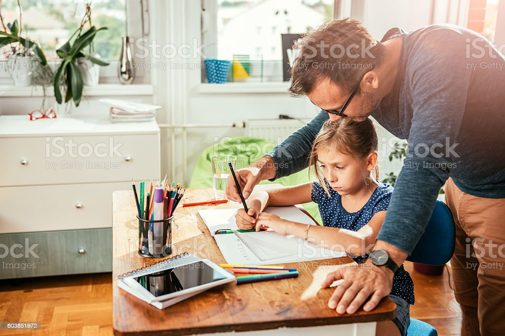 Sad School Girl having problem with homework stock photo