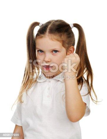 Beautiful sad school girl threatening fist.