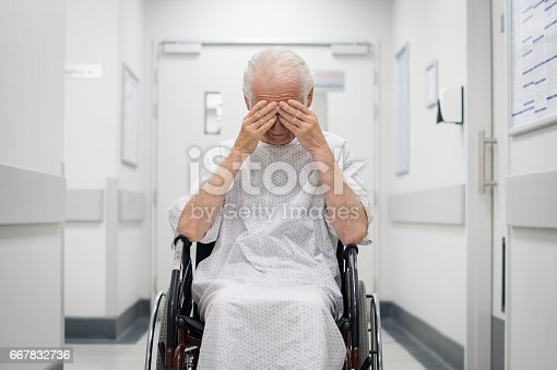 istock Sad senior man on wheelchair 667832736
