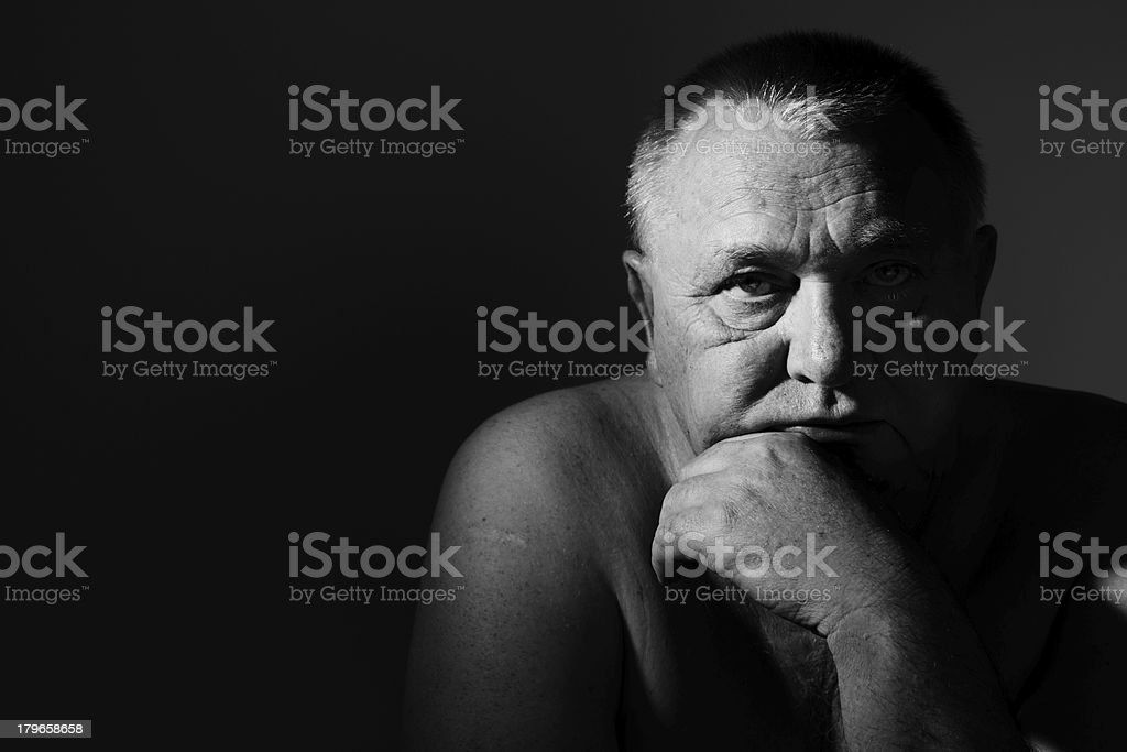 Sad senior man over black stock photo