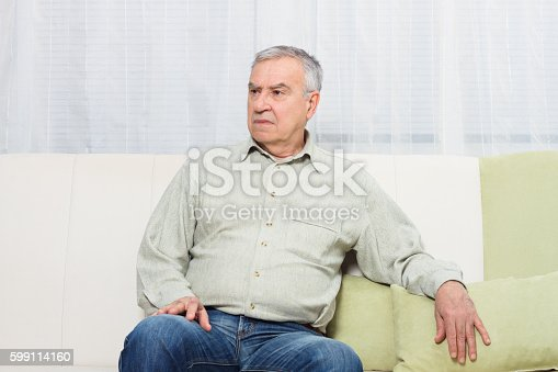 875602488 istock photo Sad senior man 599114160