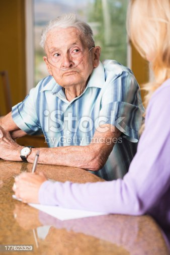 Sad senior man talking to social worker at the counter.  You might also be interested in these: