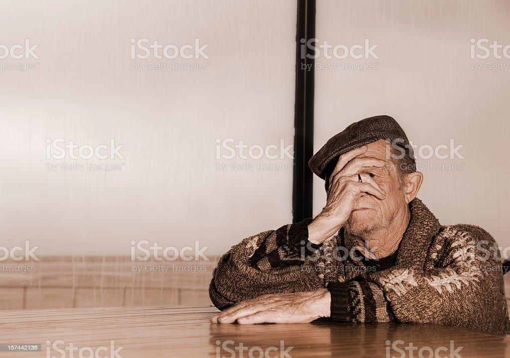 Sad senior on a rainy day royalty-free stock photo