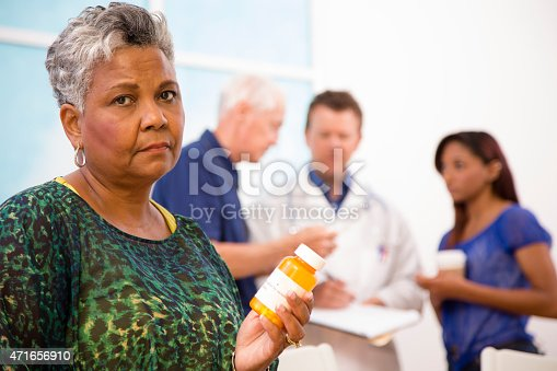 istock Sad senior woman abuses prescription medications. Doctor, patients background. 471656910