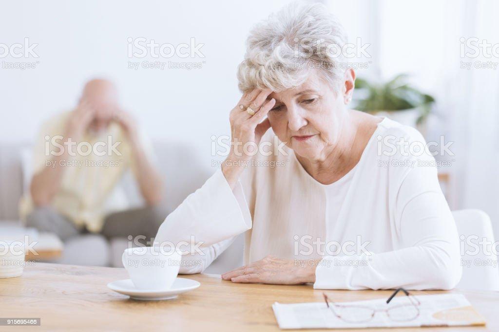 Sad senior woman after quarrel stock photo