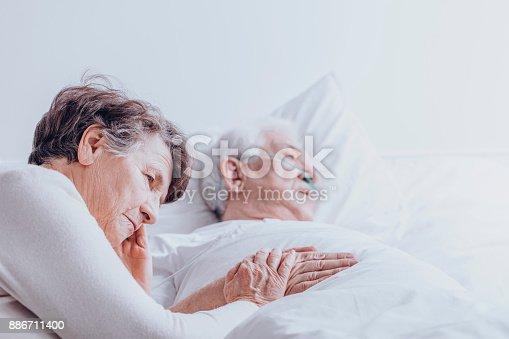 1049772134istockphoto Sad senior woman at hospital 886711400