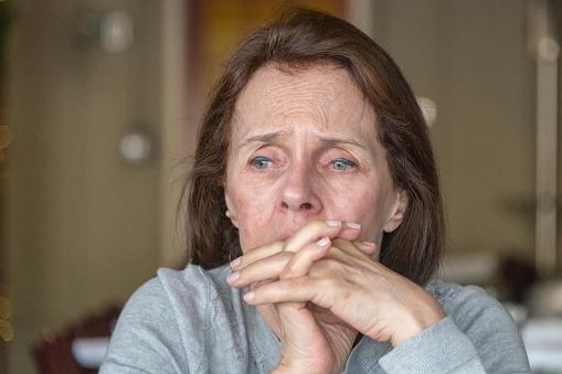 istock sad senior woman 1005068778