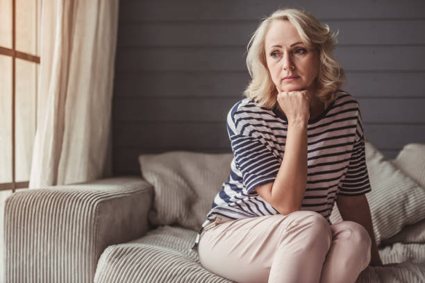 Sad senior woman stock photo