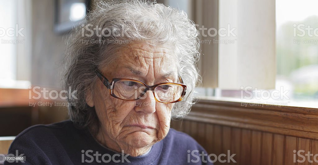 Sad Senior Woman Sitting in Restaurant royalty-free stock photo