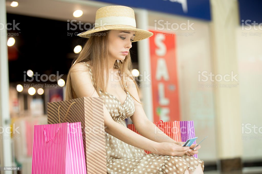 Sad shopping woman spend all money stock photo