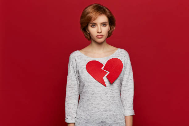 Sad single girl with big broken heart. Valentine's day and love concept Sad single girl with big broken heart. Valentine's day and love concept former stock pictures, royalty-free photos & images