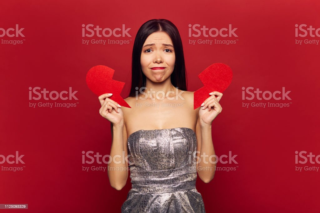 Sad single girl with big broken heart. Valentine\'s day and love...