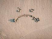 A sad smiley drawn on the sand. Depression concept.