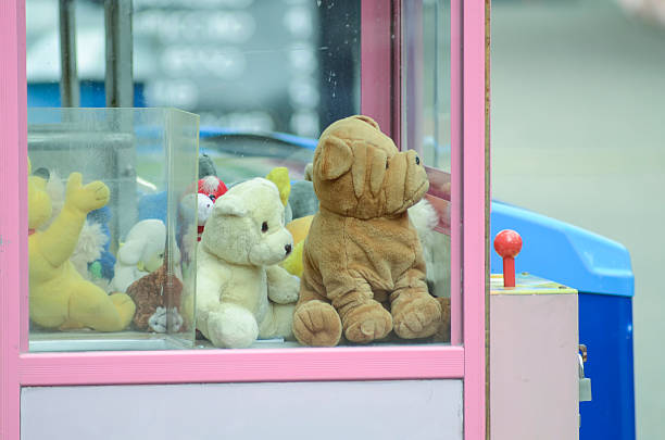 sad soft toys in slot machine, concept homeless - deplorable stock pictures, royalty-free photos & images