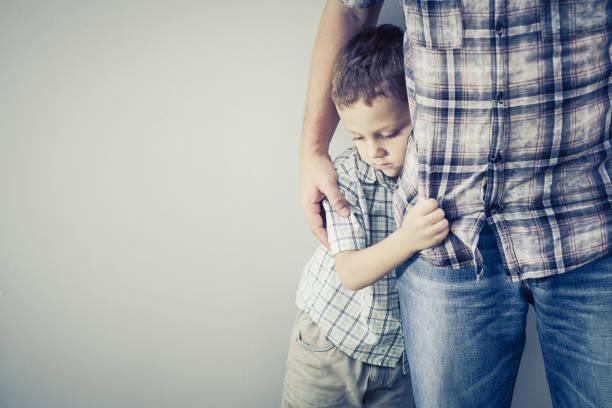 Cтоковое фото sad son hugging his dad