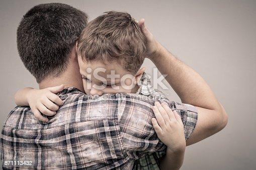 istock sad son hugging his dad 871113432