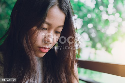 istock sad still mood of Asian women portrait closeup face with space for text 867034754