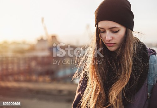 Portrait of a sad student girl at sunset
