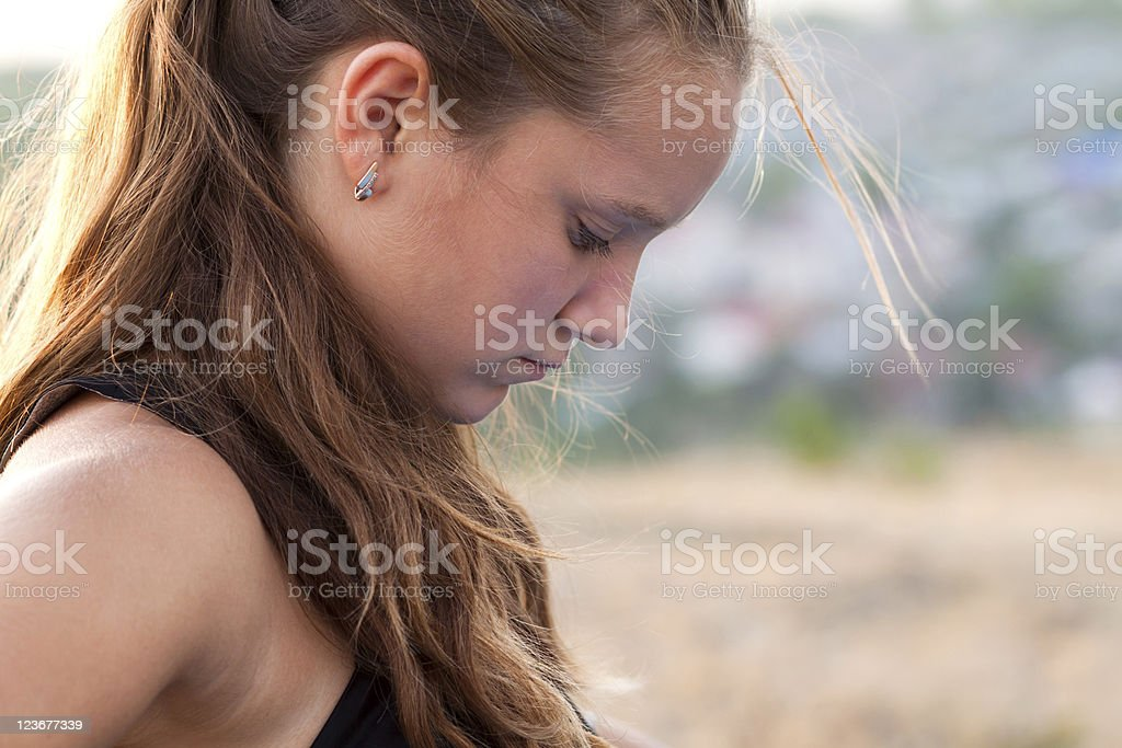 Sad teen outdoors stock photo