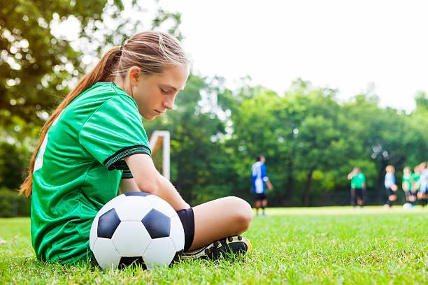 Sad teenage girl after soccer game - Photo