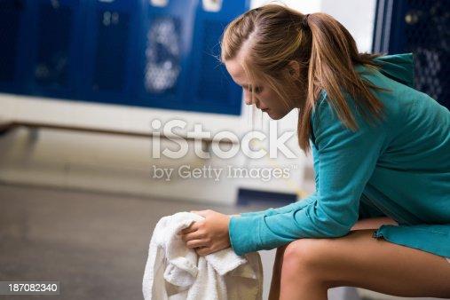 Sad Teenage Girl Sitting Alone In High School Locker Room ...