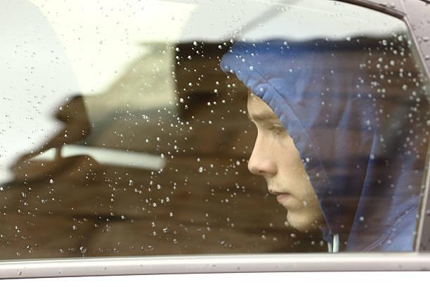 Cтоковое фото Печальный Подросток мальчик worried внутри автомобиля