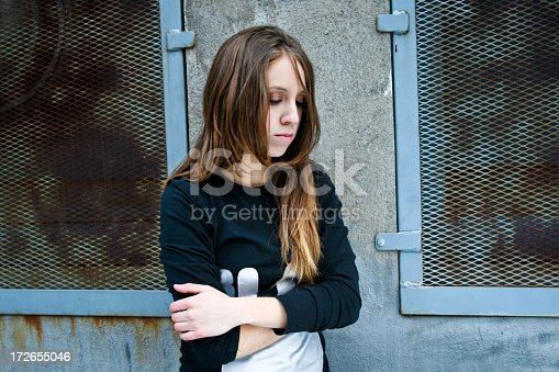 istock A sad teenager girl crossing her arms 172655046
