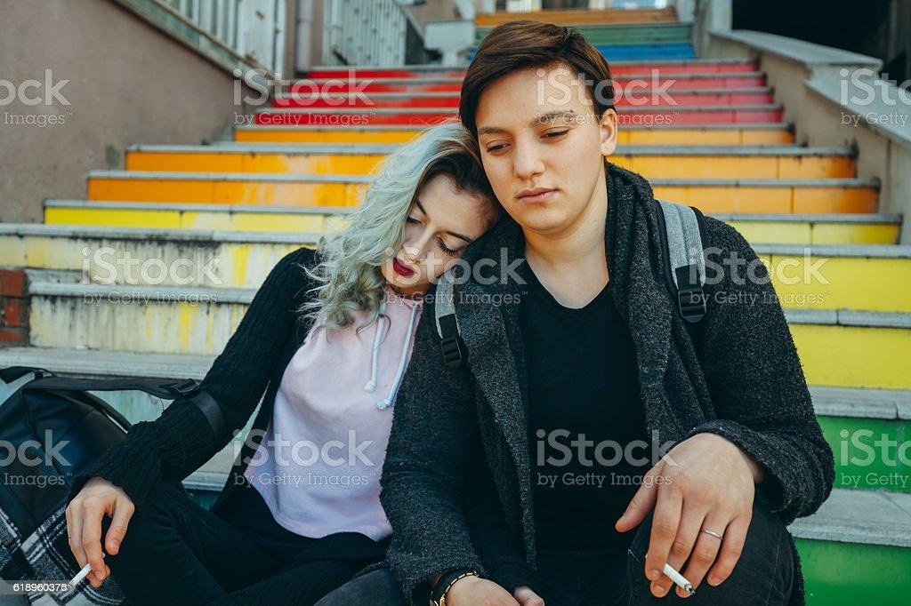 Sad urban lesbian couple enjoy stock photo