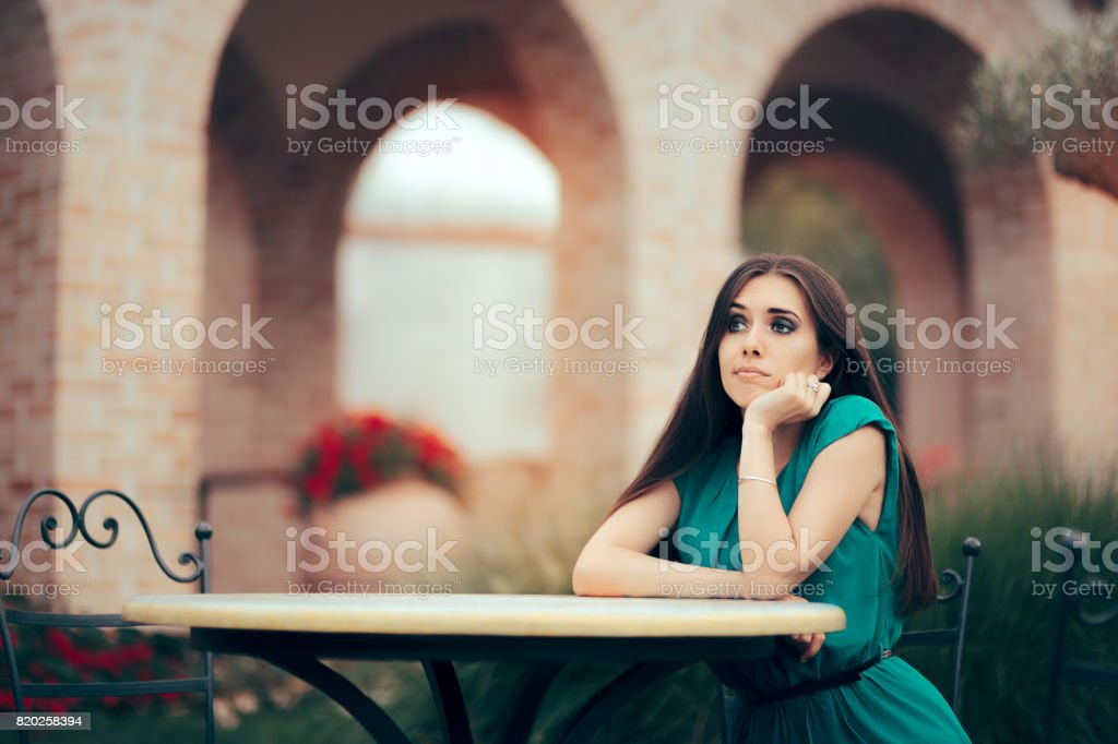 Sad Woman Being Stood Up on a Date in a Restaurant stock photo