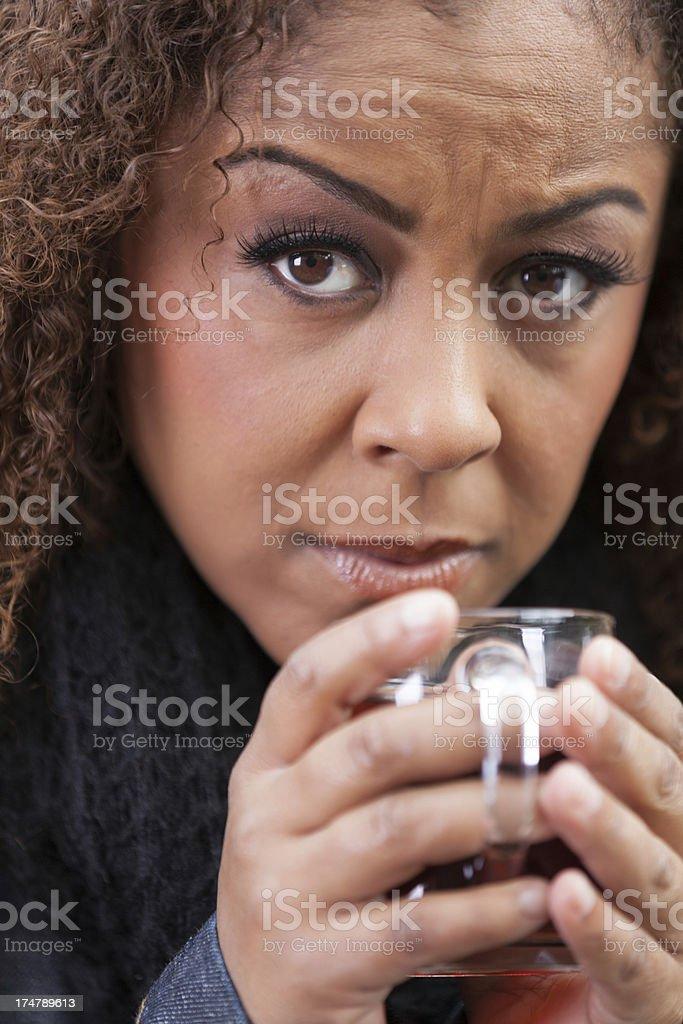 Sad woman drinking tea stock photo