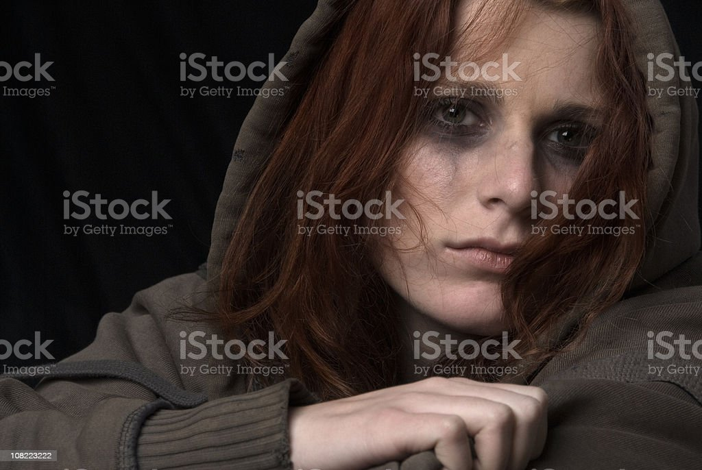 Sad woman face with smeared makeup stock photo