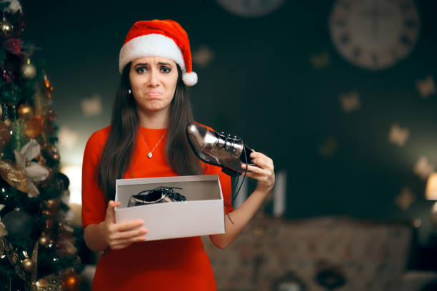 Sad Woman Hating Receiving Flat Shoes as Christmas Present Ungrateful girl with bad manners opening her Xmas present ugliness stock pictures, royalty-free photos & images