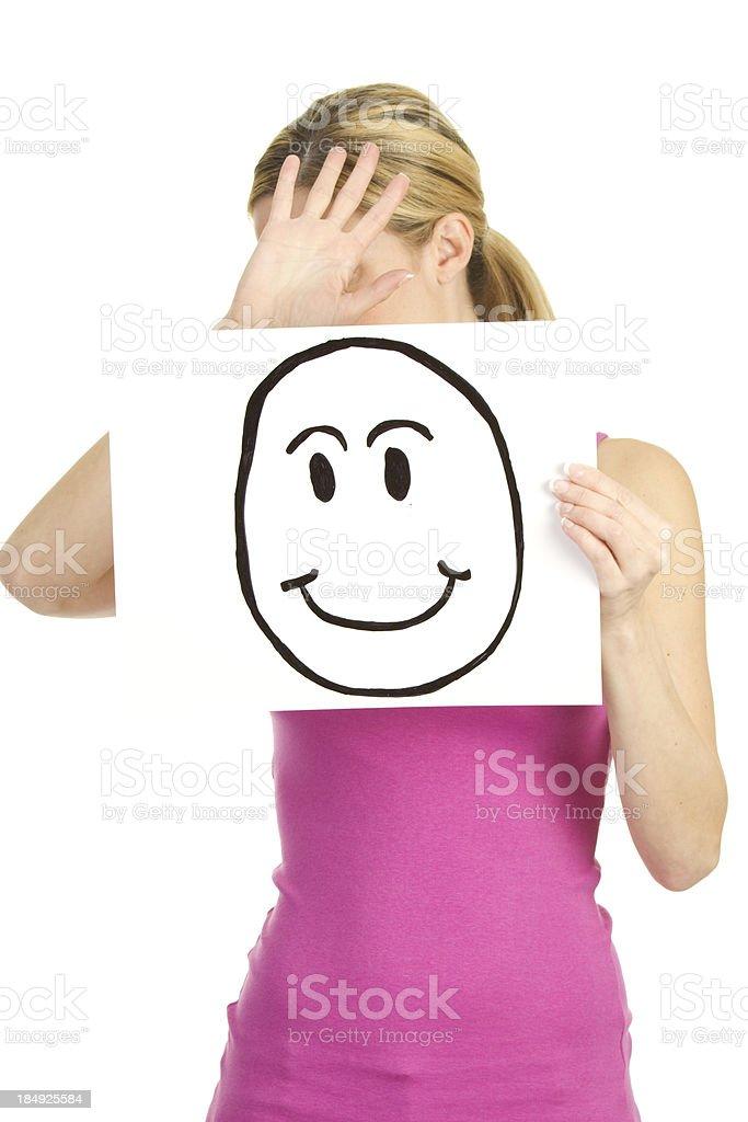sad woman hiding behind happy face royalty-free stock photo