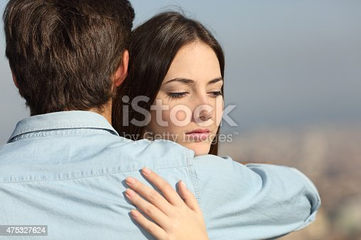 istock Sad woman hugging her boyfriend couple problems 475327624