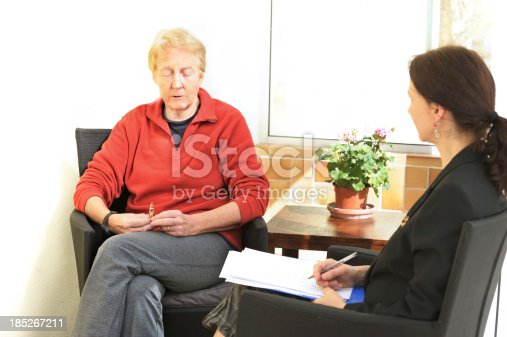 istock Sad woman in counselling session 185267211