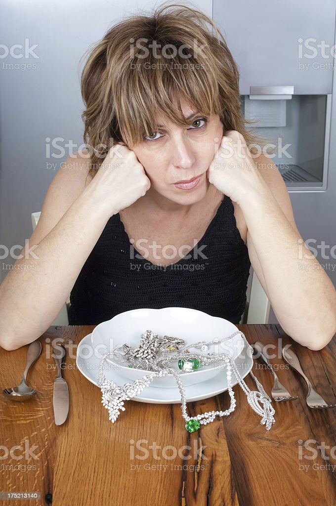 Sad Woman In Front Her Jewelleries Meal royalty-free stock photo
