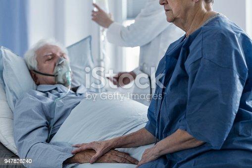 902077950istockphoto Sad woman in hospital 947826240