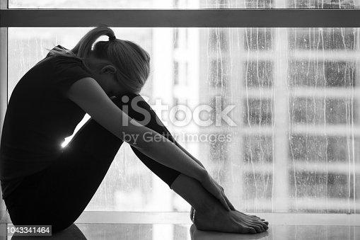 istock Sad woman in the city. 1043341464