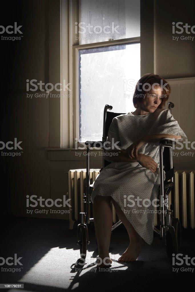 Sad Woman in Wheelchair royalty-free stock photo