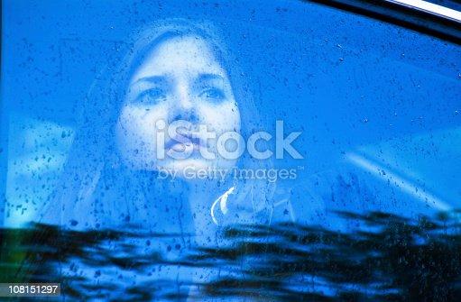 Sad Woman Looking Through A Window In The Rain Stock Photo ...