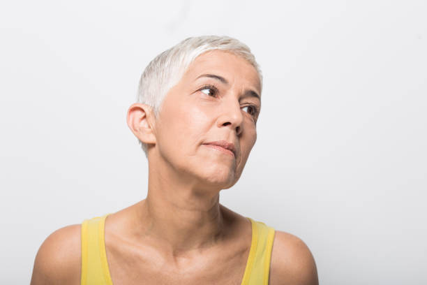 sorgliga kvinna - mature women studio grey hair bildbanksfoton och bilder