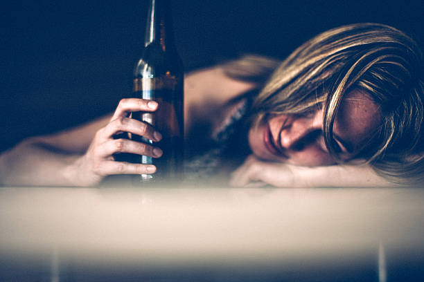 sad woman - drunk stock photos and pictures